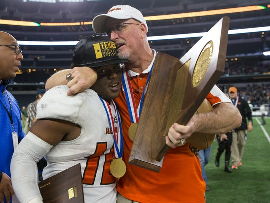 Refugio head coach Jason Herring embraces Jacobe Avery after the Bobcats' 23-20 win over Crawford in the 2016 Class 2A Division I state championship at AT&T Stadium in Arlington.