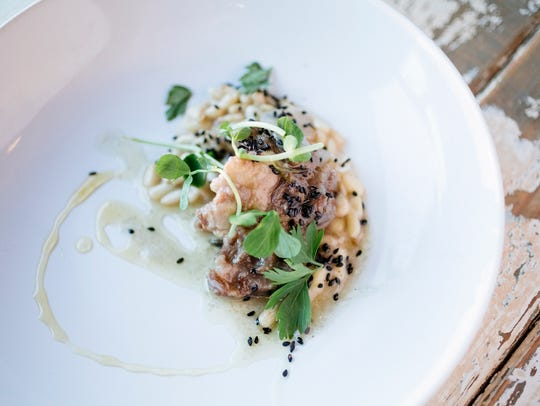 Lamb with black sesame and pine nut risotto by chef