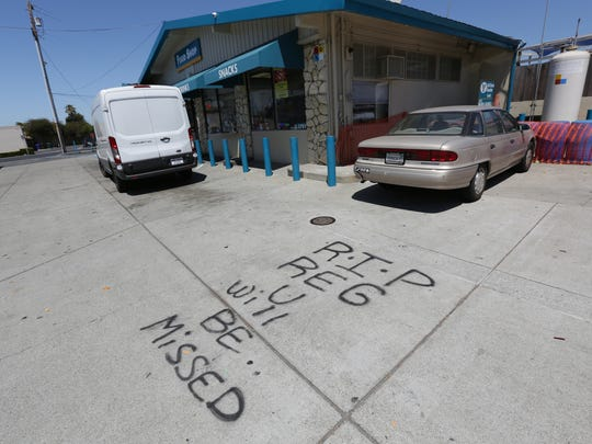 A spray painted memorial for a man who was killed at a gas station in Richmond, Calif. on July 14, 2016.