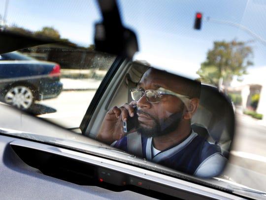 Neighborhood Change Agent Joe McCoy drives around Richmond,