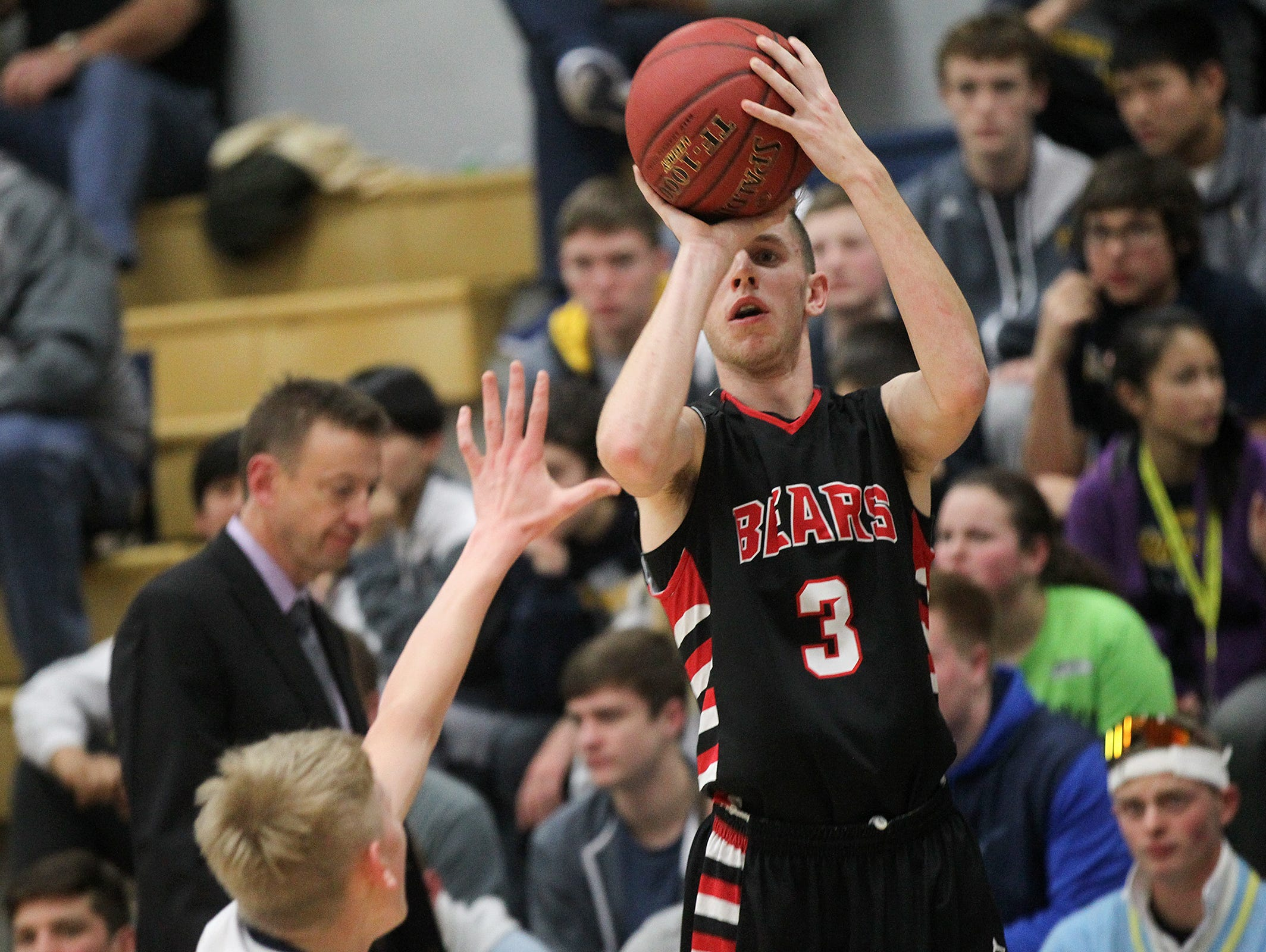 West Branch's Beau Cornwell shoots a 3-pointer during the Bears' game at Regina on Friday, Dec. 16, 2016.