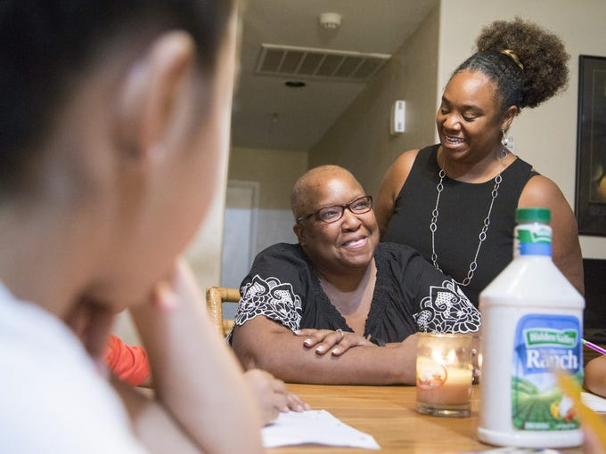 Donna (left) and Sharicka McHenry talk to their adopted