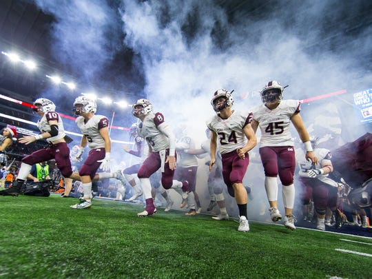 Calallen takes the field at AT&T Stadium in Arlington Texas for the Class 5A Division II state championship game against Aledo on Friday, Dec. 16, 2016.