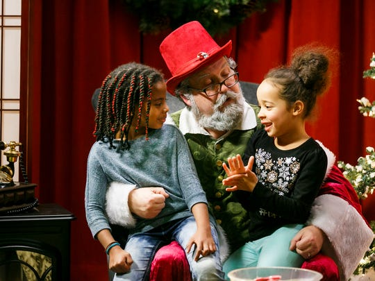 Maleya Ellis, left, and Aliyah West, right, tell Santa what they want for Christmas at Capital Community Television's annual Talk to Santa event on Saturday, Dec. 17, 2016, at CCTV in Salem. Kids were also invited to call into the studio and talk to Santa over the phone.