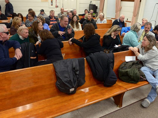 The Borough Council kept residents waiting while council was in a closed door meeting. The meeting was to finally choose one of three options for development of the 14-acre Suez tract. in New Milford, NJ. December 21, 2016.