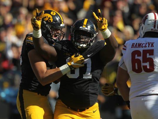 Iowa's Jaleel Johnson celebrates his second sack during