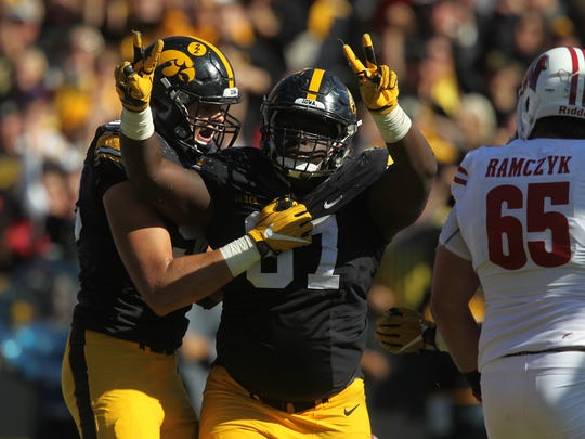 Iowa's Jaleel Johnson celebrates his second sack during the Hawkeyes' game against Wisconsin at Kinnick Stadium on Saturday, Oct. 22, 2016.