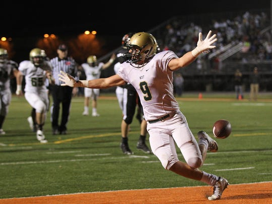 West High's Dillon Doyle celebrates his touchdown in the final minutes of the Trojans' game against Cedar Rapids Prairie in Cedar Rapids on Friday, Nov. 4, 2016.