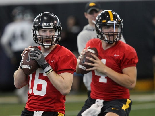 Iowa quarterbacks C.J. Beathard, left, and Nate Stanley run drills at the indoor practice facility on Dec. 22, 2016.
