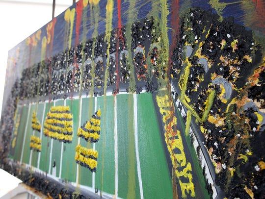 Heidi Schickel's painting of Kinnick Stadium is pictured
