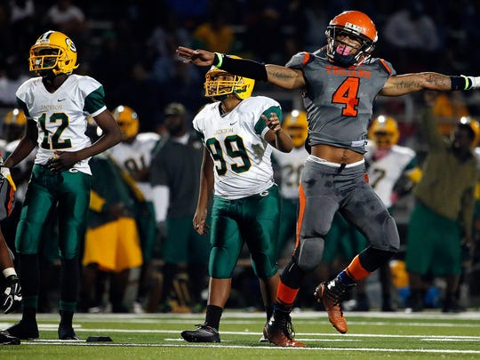 Lely's Kendall Duckworth (4) signals a no good field goal as Miami-Jackson looks on Friday, Nov. 14, 2014 at Lely High School. The Trojans held off the Generals 28-25 for their first post season victory since 1987. (Corey Perrine/Staff)