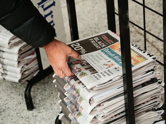 Copies of the Thanksgiving edition of the Detroit Free Press wait for customers to pick up in advance at the Detroit Newspaper Partnership Sterling Heights Operations Facility in Sterling Heights on Wednesday Nov. 23, 2016.