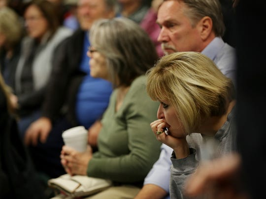 Residents affected by the sinkhole at 15 Mile Road and Eberlein attend a meeting hosted by the City of Fraser to answer questions and discuss upcoming fixes on Monday December 26, 2016.