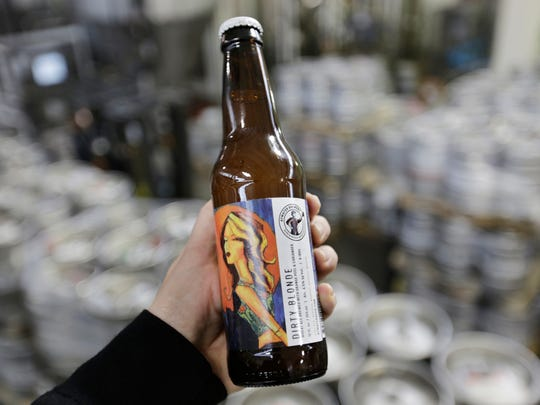 Dirty Blond wheat ale with orange peel and coriander is one of the most popular beers from the Atwater Brewery in Detroit on Tuesday December 27, 2016.