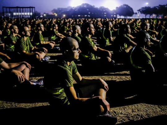 New male recruits stretch before beginning their Initial