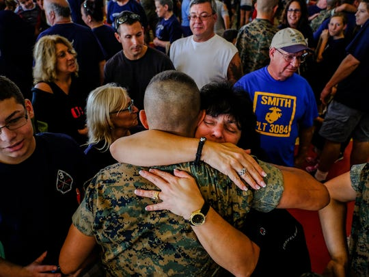 Laura Serce, of Rochester, NY, hugs her nephew Peter Tubiolo, 18, at the base's All-Weather Training Facility during family day where families got to see their sons and daughters for the first time in three months on Wednesday October 19, 2016 at the Marine Corps Recruit Depot in Parris Island, SC.