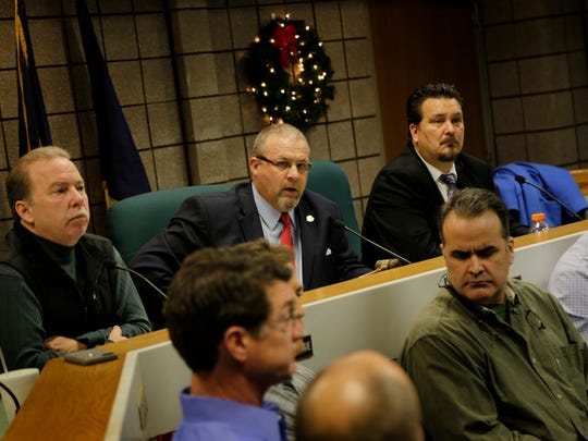 Fraser mayor Joe Nichols, center answers questions from residents displaced by the sinkhole at 15 Mile Road and Eberlein during a meeting hosted by the City of Fraser on Monday December 26, 2016.