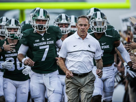 Michigan State team runs out of the tunnel to the field