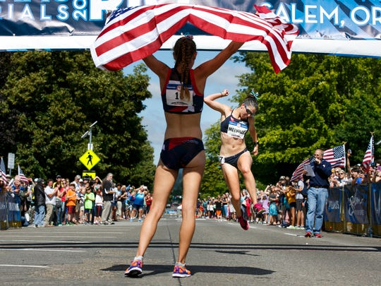 Maria Michta-Coffey stands ready to greet teammate Miranda Melville as she celebrates and crosses the finish line to take second place in the women's 20-kilometer race walk during the U.S. Olympic Track & Field Team Trials on Thursday, June 30, 2016, in Salem, Ore. Both Michta-Coffey and Melville qualified for the 2016 Olympics in Rio de Janeiro.