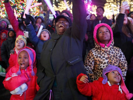 From left, Anaya Harris, of Detroit, Charlotte Harris of Detroit, Heaven Griffin, of Arizona and Amari Harris of Detroit celebrate as the D drops during the Kids' Drop on New Year's Eve on Saturday, Dec. 31, 2016 in Campus Martius Park in downtown Detroit.