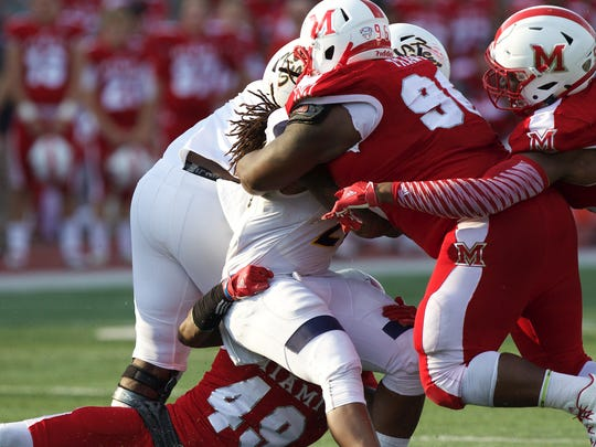 Richmond graduate Nate Trawick (96) helped the Miami (Ohio) football team become the first to ever play in a bowl game after starting the season 0-6.