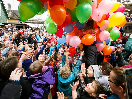 "Children and parents cheer as balloons drop onto the crowd at noon at Gilbert House Children's Museum ""Noon"" Year party on Saturday, Dec. 31, 2016. The museum's hands-on exhibits were open for children to play with, as well as special stations for face painting, crafts and balloon animals."