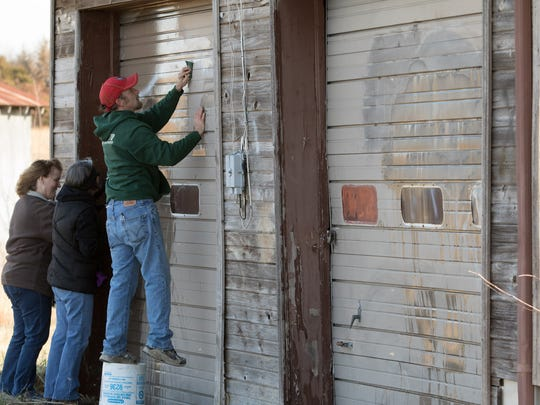 Approximately  30 volunteers that came out Saturday, December 31, 2016 to clean up mess created by vandals of an old service station owned by Glenn and Ann Edwards. Jason Connel / For the News-Leader