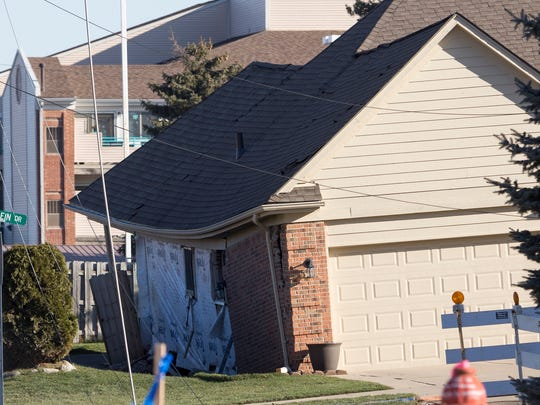 The Eberlein Drive home damaged by the sinkhole shows