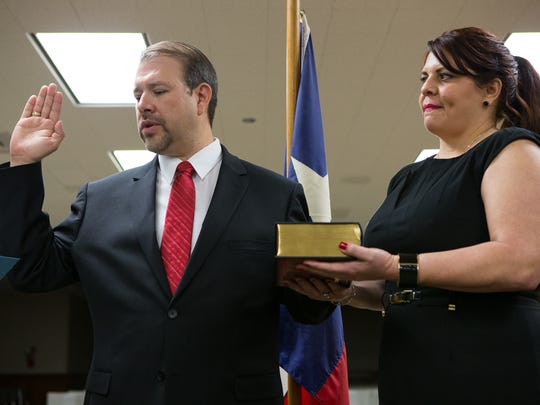 John Marez is sworn in as Nueces County Precinct 3 commissioner during a ceremony at the Nueces County Courthouse on Sunday, Jan. 1, 2016.