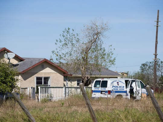 A Corpus Christi police crime scene vehicle is parked along FM 1833 in Robstown on Tuesday, Jan. 3, 2017. The body of a woman was found there.
