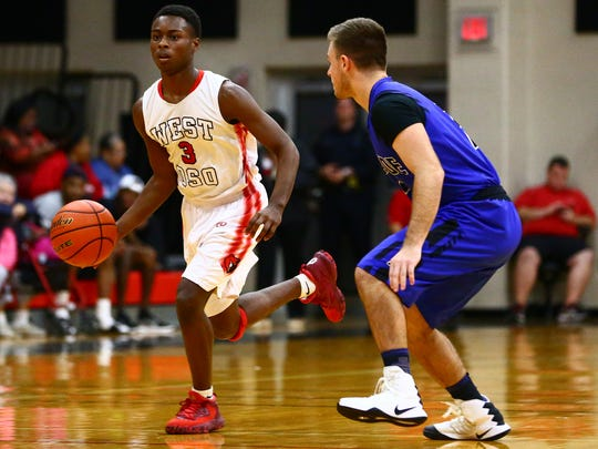 West Oso's Creighton Avery drives the ball up the court during the first quarter of their game against Ingleside at West Oso on Tuesday, Jan. 3, 2016.