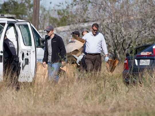 Corpus Christi Police collect evidence where the body of Breanna Wood was found along FM1833 in Robstown on Tuesday, Jan. 3, 2017.