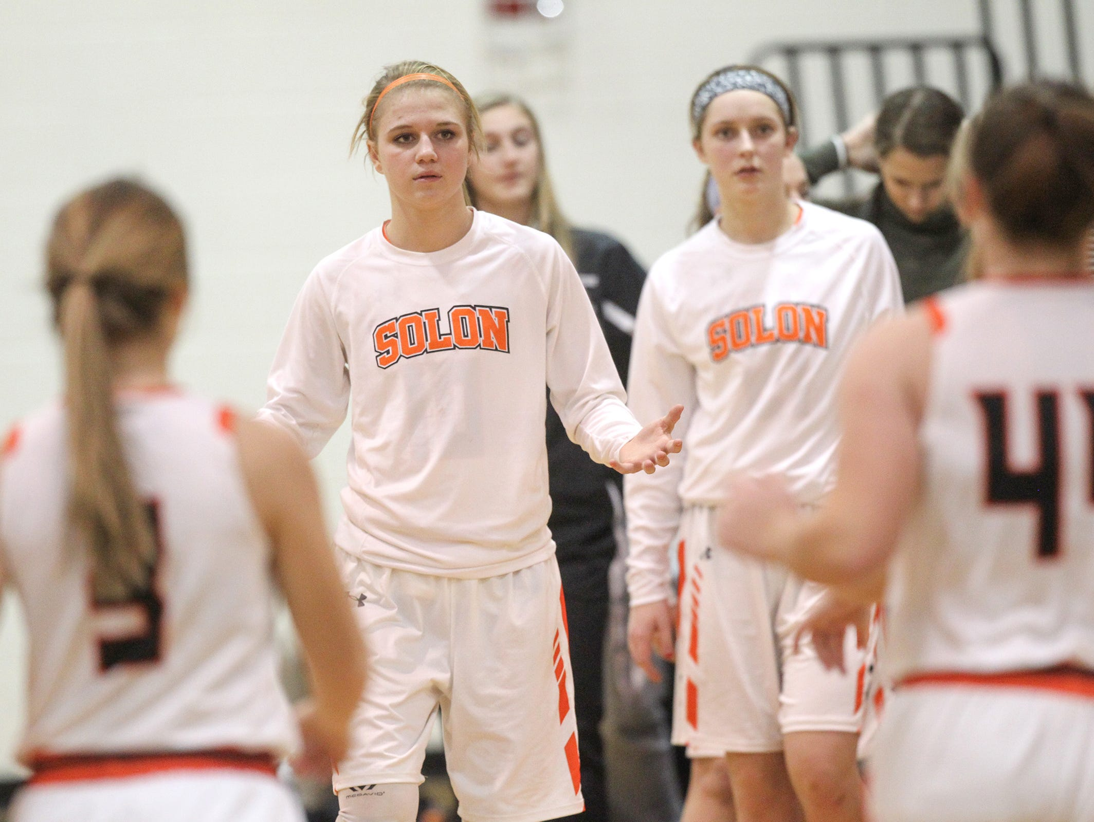 Solon's Saige Hauer high-five's teammates as they head into a timeout during the Spartans' game against West Delaware on Friday, Jan. 6, 2017.
