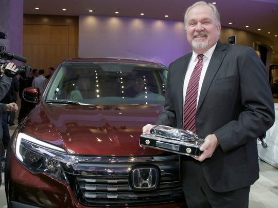 John Mendel, Executive Vice President at Honda, accepts the 2017 North American International Auto Show Truck of the Year award at the North American International Auto Show on Monday Jan. 9, 2017 in the atrium at Cobo Center in Detroit.