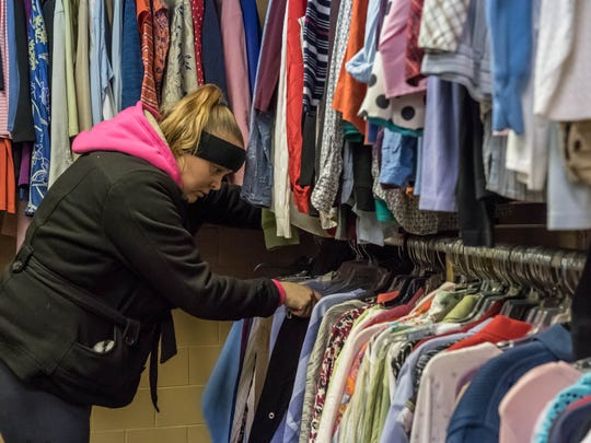 Sheridan Cody shops for winter clothes at the Charitable Union.