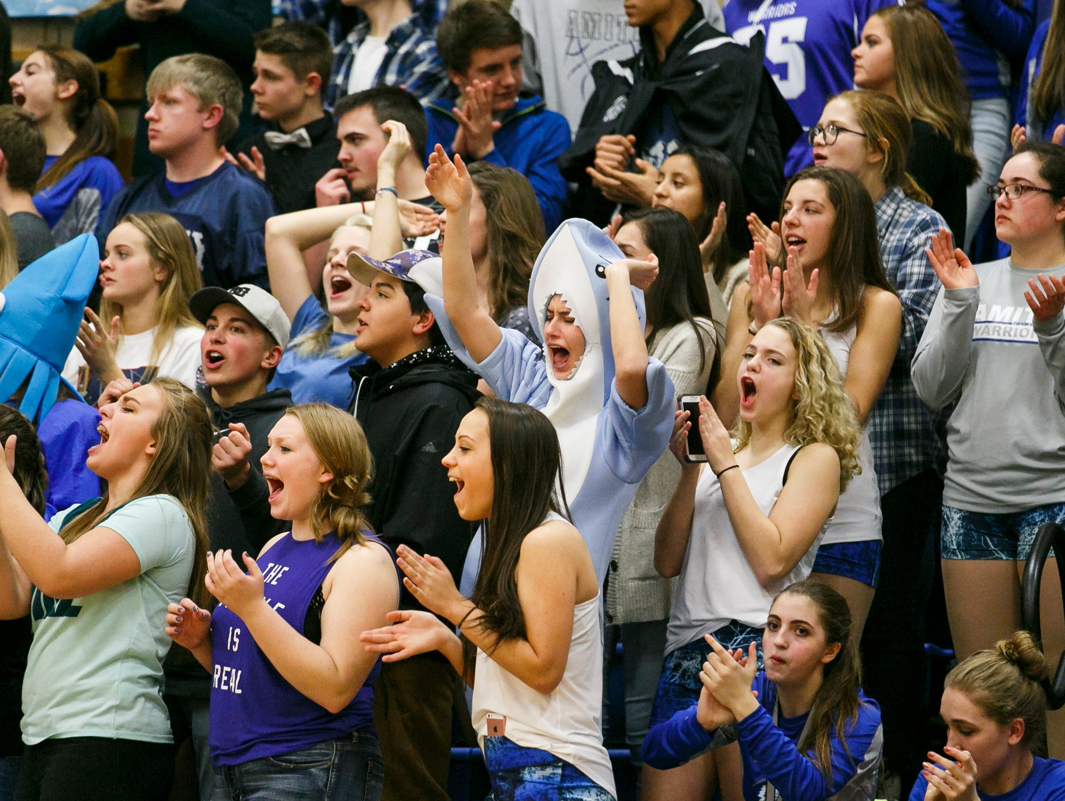 Amity students and fans cheer as they score a basket against Dayton in the first quarter of a West Valley League game on Monday, Jan. 9, 2017, at Amity High School. Dayton defeated long-time rival Amity 92-67.