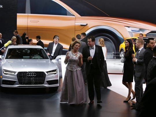People walk around the Audi displays during the 2016