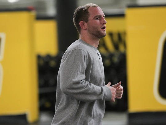 Iowa's Alex Marinelli warms up during practice at Carver-Hawkeye