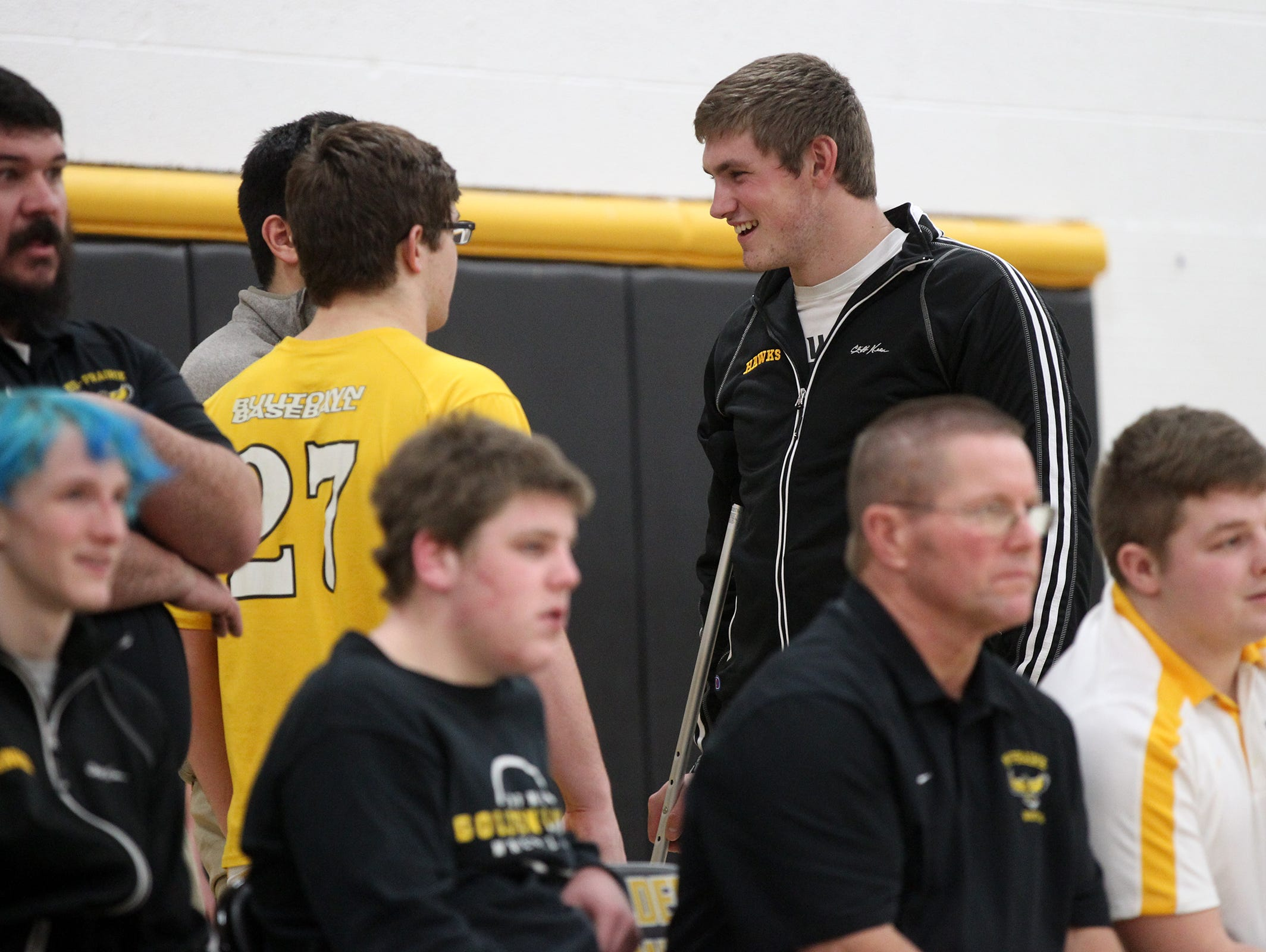 Mid-Prairie's Levi Duwa chats with friends before the Golden Hawks' dual against Cascade at Mid-Prairie on Thursday, Jan. 12, 2017.