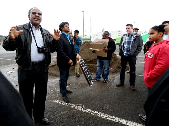 Benny Williams, left, the president of the Salem-Keizer branch of the NAACP, speaks before a march in celebration of Martin Luther King Jr. Day in Salem on Monday, Jan. 18, 2016.