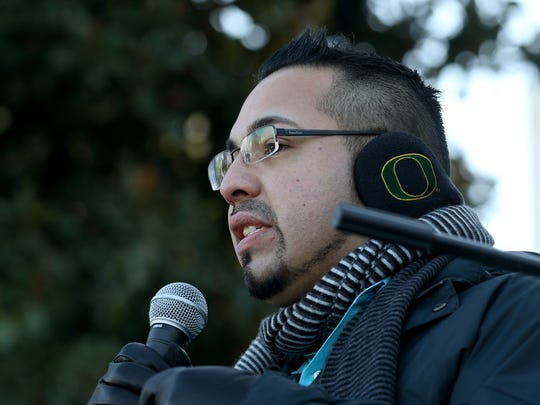 Rep. Diego Hernandez speaks during an immigrant rights rally at the Oregon State Capitol in Salem on Saturday, Jan. 14, 2017.