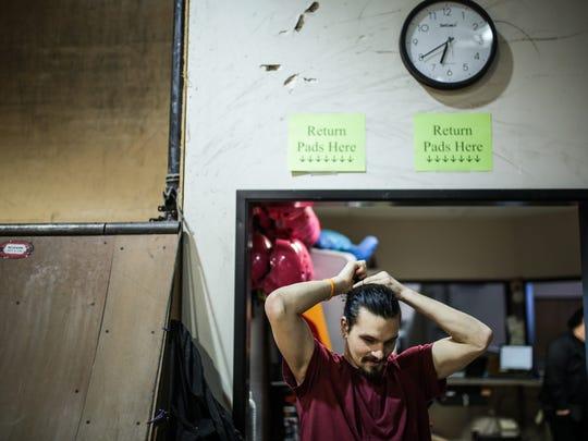 Nick Mullins, 25, fixes his hair before skateboarding