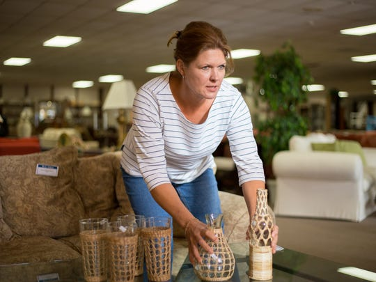 "Michele Roark, who has appeared on HGTV's ""Decorating Cents,"" arranges displays Jan. 10 at the Habitat for Humanity Home Furnishings ReStore location in East Naples. She will host a DIY seminar for the public Wednesday on how home owners can arrange furniture, artwork and accessories."