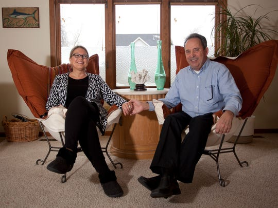 Phil and Cindi Shaftner pose for a portrait in their home in Lansing on Wednesday. Cindi's wedding ring was accidentally flushed down the toilet.