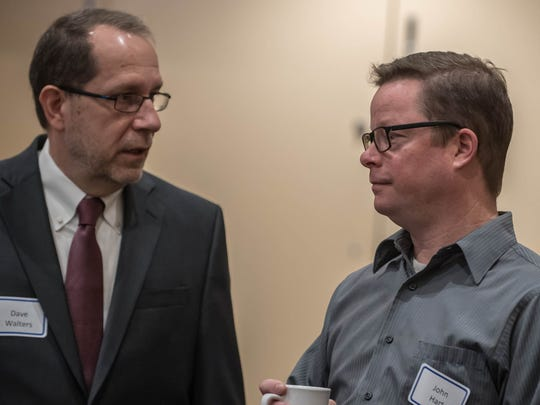 Battle Creek Mayor Dave Walters and Downtown Development Director John Hart at the 2017 Economic Outlook meeting Thursday at McCamly Plaza Hotel in Battle Creek.