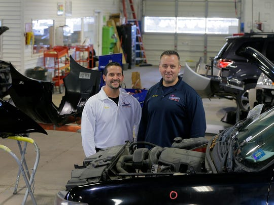 Nicholas Hindy and James Pasquin, owners of Anthony's Auto Body, talk about the business at their location in Shrewsbury.