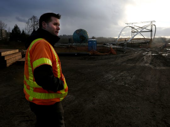 Aaron Kimsey, a project manager with Salem Public Works, walks on the contruction site of the Minto Island Bridge in Salem on Thursday, Jan. 19, 2017. A soft opening in April is expected.