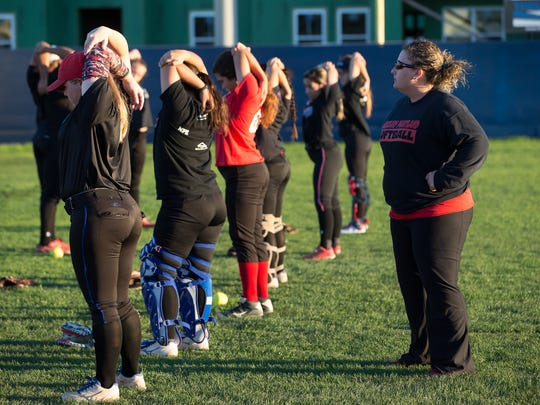 Gregory-Portland's softball coach Felicia Talamantez as the team warms up at the start of practice on Monday Jan. 32, 2017