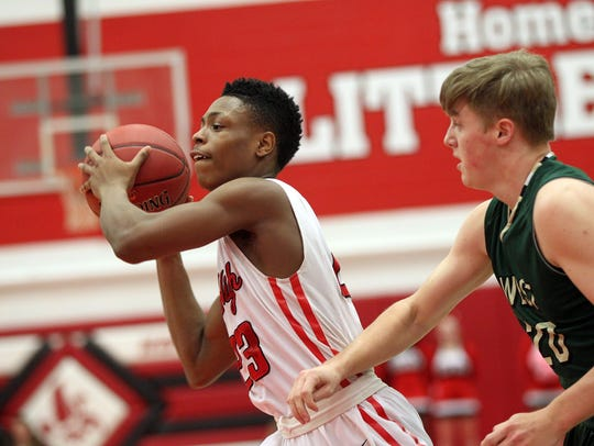 City High's Keshawn Christian looks for an open teammate