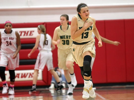 West High's Rachael Saunders celebrates a 3-pointer
